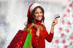 Woman showing her credit card while shopping before Christmas