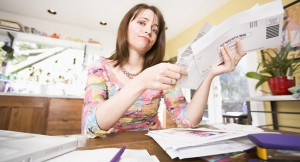 Woman looking at bills in mail