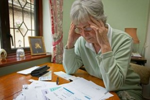 elderly-woman-worried-at-bills