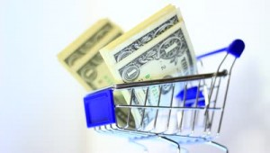 stock-footage-small-shopping-cart-with-paper-money-consumption-commerce-business-conceptual-clip